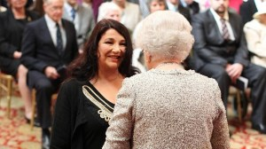 Kate Bush receives her CBE from Queen Elizabeth at Windsor Castle. (photo credit: msn.uk)