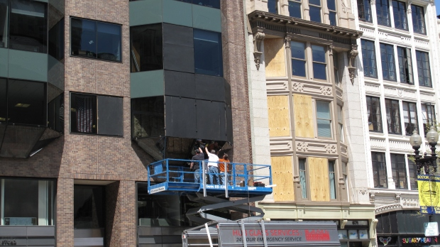Repairing glass on Boylston Street where the first bomb went off.