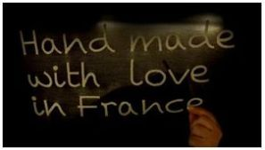 "A screen shot of the hand-embroidered title card for ""Handmade with Love in France"". (credit: Julie Georgia Bernard/Vimeo)"