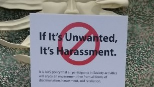 A sign at the 2016 American Astronomical Society conference, notifying attendees of the society's anti-harassment policy. (credit: cnn.com)