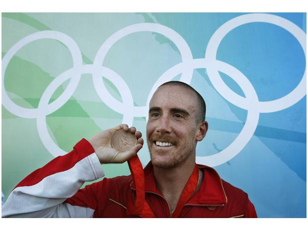 Thomas Hall with his bronze medal at the 2008 Olympics. (credit: Shaun Hall/Reuters/National Post)